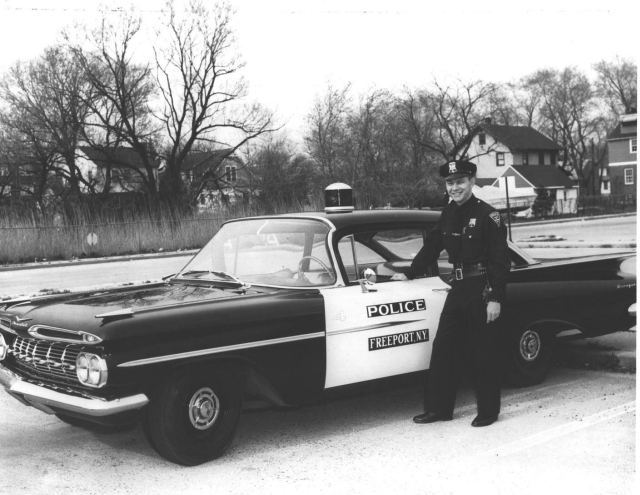 Ptl. Arthur Rousseau with new police car 4-20-1959.jpg
